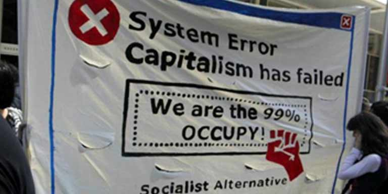 protest banner that states System Error Capitalism has failed