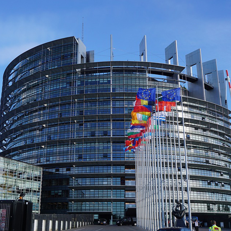 European union building with flags of nations
