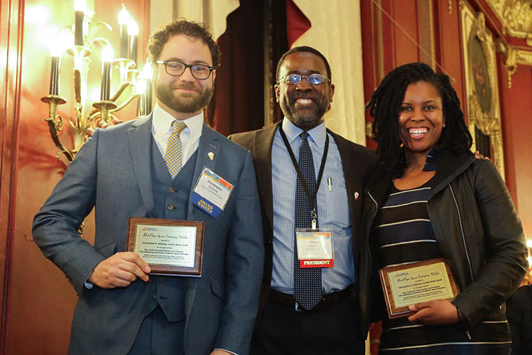 Three people posing for a photo, two of which are DeSante Award winners